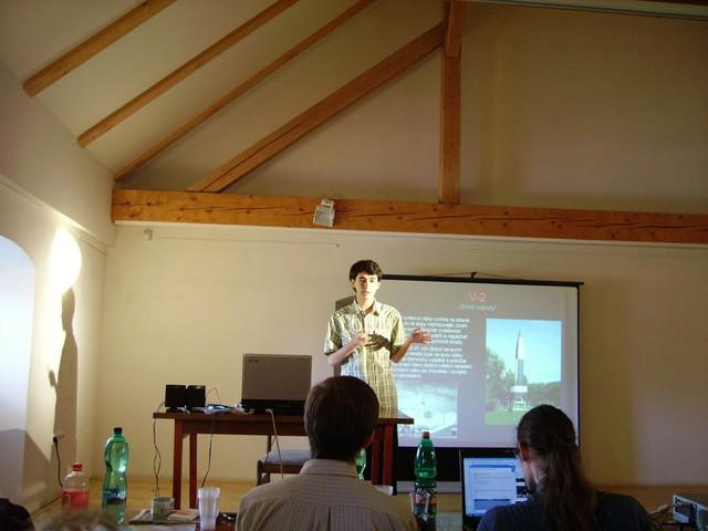 M. Polák při své přednášce